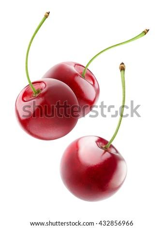 isolated cherries. three flying ...