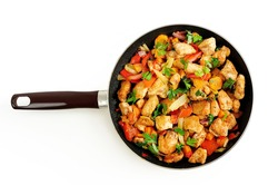 Isolated chicken with vegetable on frying pan