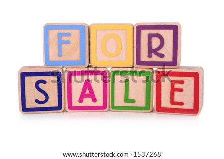 Isolated children's building blocks spelling the words for sale
