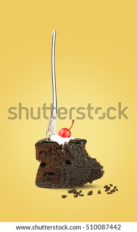 Isolated Chocolate cherry cake with fork on yellow background. Chocolate pie. Flying brownie with cream. Chocolate cherry cake with fork.