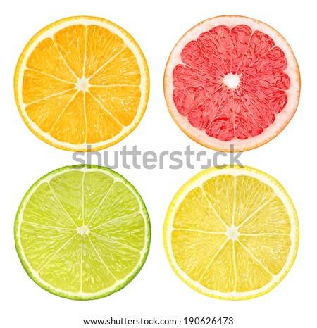 Isolated citrus fruits. Slices of orange, pink grapefruit, lime and lemon fruits isolated on white background #190626473