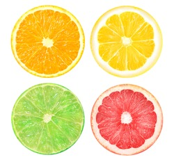 Isolated citrus. Slices of orange, pink grapefruit, lime and lemon fruits isolated on a white background to photograph closeup