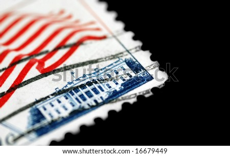 isolated close-up of the white house on an old postage stamp