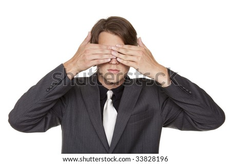 Isolated close up studio shot of a businessman in the See No Evil pose.