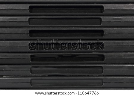 Isolated closeup of black plastic dvd safety covers.
