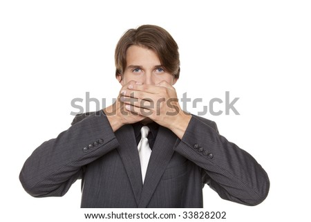 Isolated closeup studio shot of a businessman in the Speak No Evil pose.