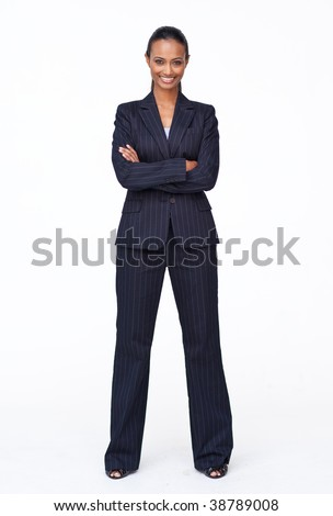 Isolated confident Indian businesswoman smiling at the camera agaisnt white