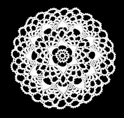 Isolated crocheted laced white doily with many arches and picos at the egde on a black background. Round decorative cotton doily. Top view