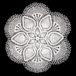 Isolated crocheted white doily with a pattern of cones on a black background. Round decorative cotton doily. Top view