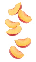 Isolated cut peaches. Six pieces of fresh peach fruits in the air isolated on white background