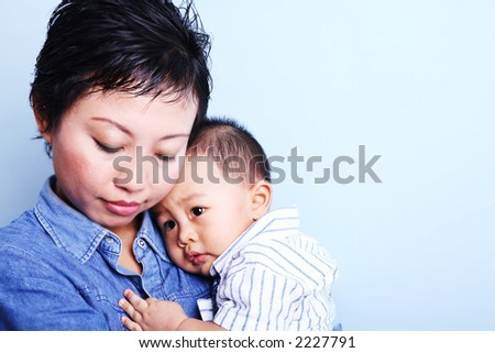 Isolated cute Asian baby boy with his mother