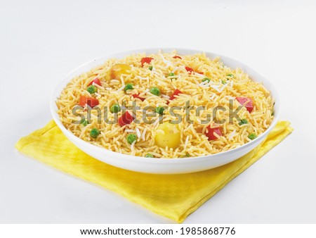 Isolated delicious rice in white bowl on white background, Indian or Pakistani ramzan food. Beautiful view of traditional spicy indian food, Iftar meal, Ramadan dinner.