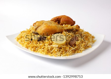Isolated delicious spicy chicken biryani in white bowl on white background, Indian or Pakistani ramzan food. Beautiful view of traditional spicy indian food, Iftar meal, Ramadan dinner.