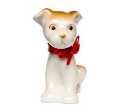 Isolated dog from porcelain on a white background. Isolated dog - symbol 2018 New Year.