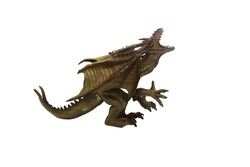 Isolated dragon toy photo.  Isolated monstrous dragon toy photo side view.