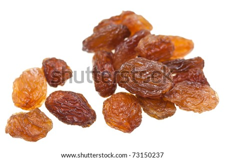 Isolated dried raisins with white background.