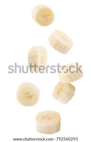 Isolated falling fruits. Falling sliced banana fruit isolated on white background with clipping path as package design element.