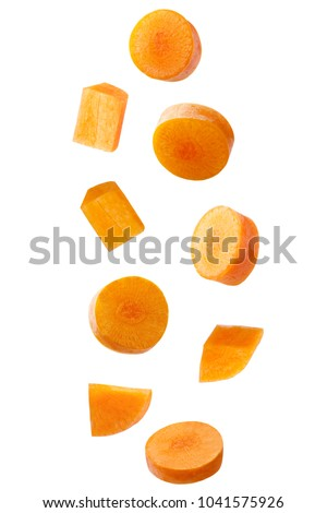 Isolated falling vegetables. Falling carrot isolated on white background with clipping path as package design element.