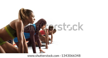 Isolated Female athletes sprinting. Women on white background in sport clothes on starting line prepares to run. Muslim athlete in sports hijab