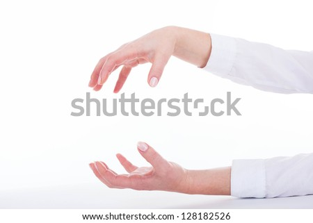 Isolated female hands in grasping gesture.