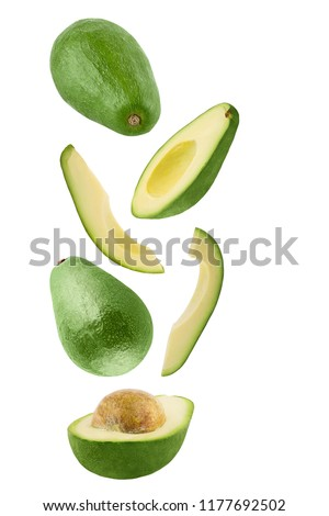Isolated flying avocado. Falling fresh avocado isolated on white background with clipping path as package design element and advertising. #1177692502