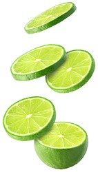 Isolated flying limes. Falling sliced lime fruit isolated on white background with clipping path