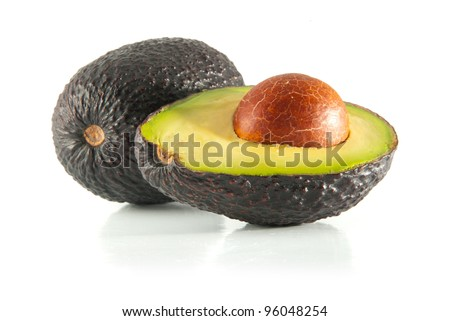 Isolated fresh avocado cut in half with seed