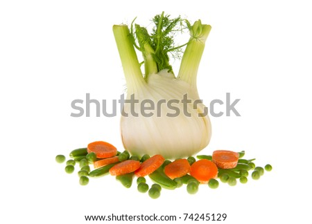 Isolated fresh fennel with sugar snaps, green peas and carrots