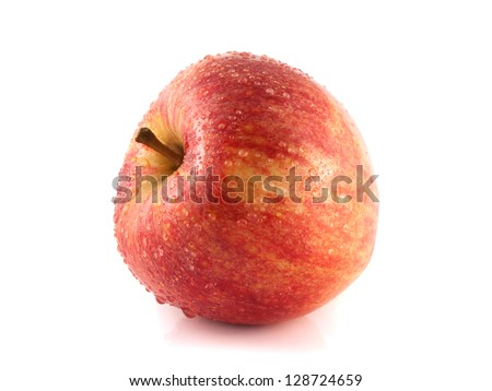 Isolated fresh red apple with water drops. Fresh diet apple. Healthy wet fruit with vitamins.