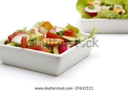 isolated fresh salad in a white plate