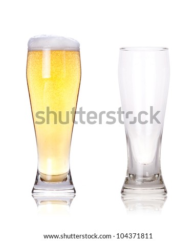 Isolated full and empty glass of beer - stock photo