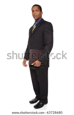 Isolated full length studio shot of a confident businessman looking at the camera while holding a notepad.