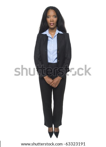 Isolated full length studio shot of a confident businesswoman standing and looking at the camera.