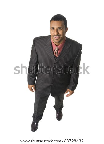 Isolated full length studio shot of an overhead view of a happy businessman smiling up at the camera.