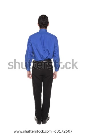 Isolated full length studio shot of the rear view of a Caucasian businessman standing with arms at sides and looking away.