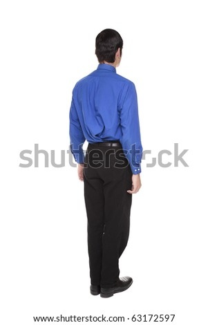 Isolated full length studio shot of the rear view of a Caucasian businessman standing with arms at sides and looking away to the right.