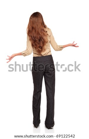 Isolated full length studio shot of the rear view of a Caucasian businesswoman looking up in disbelief with arms raised.