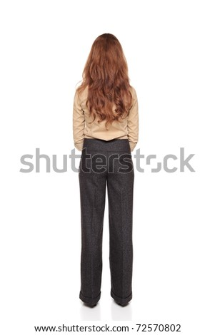 Isolated full length studio shot of the rear view of a Caucasian businesswoman standing with hands clasped.