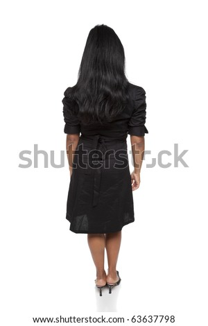 Isolated full length studio shot of the rear view of a Latina businesswoman.
