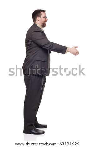 Isolated full length studio shot of the side view of a businessman reaching out to shake hands
