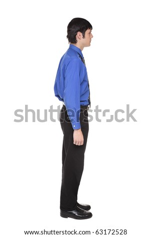 Isolated full length studio shot of the side view of a Caucasian businessman standing with arms at sides and looking away to the right.