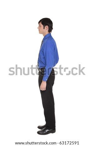 Isolated full length studio shot of the side view of a Caucasian businessman standing with arms at sides and looking away to the left - stock photo