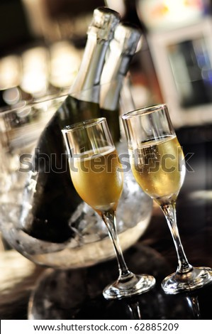 Isolated glasses of champagne with bottle background