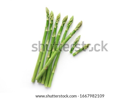 Isolated green fresh sliced asparagus. Top view.  Stock fotó ©