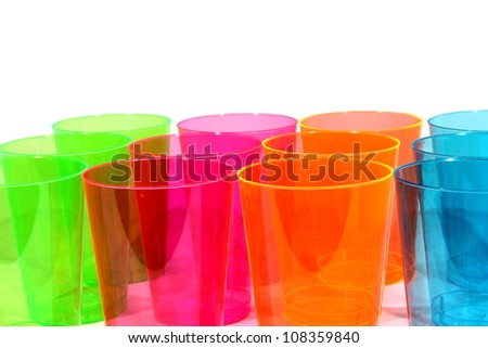 Isolated green, red, orange, and blue plastic cups.