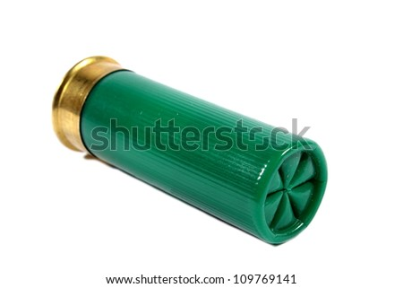 Isolated green shotgun shell used for hunting large animals or self defense.