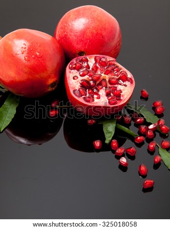 Isolated group pomegranate with leaf and seed on black background #325018058