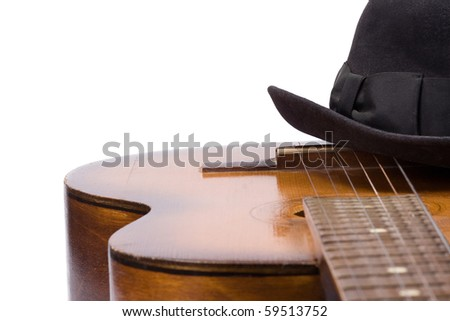 isolated guitar and hat on white