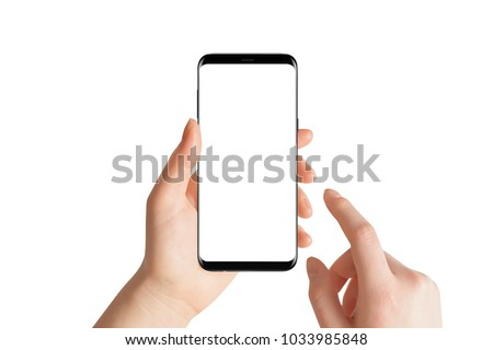 Isolated hands and smartphone on white background. Female hand holding modern black phone in vertical position.