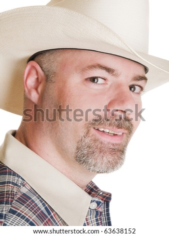 Isolated headshot of a man in a cowboy hat.
